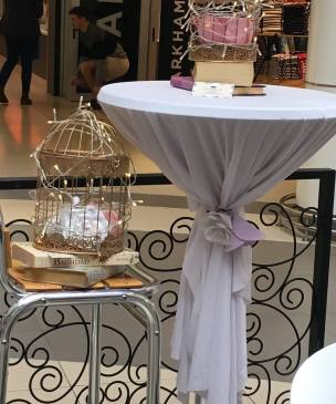 Fairy lights were added with paper flowers in the cages